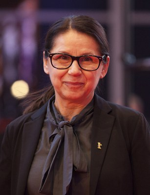 Ildikó Enyedi, b. 1955, is a Hungarian director and screenwriter. In 2017, Enyedi won the Golden Bear at the 67th Berlin International Film Festival for her film On Body and Soul. In 2017, she was accepted into the Academy of Motion Picture Arts and Sciences that awards the annual Oscars.